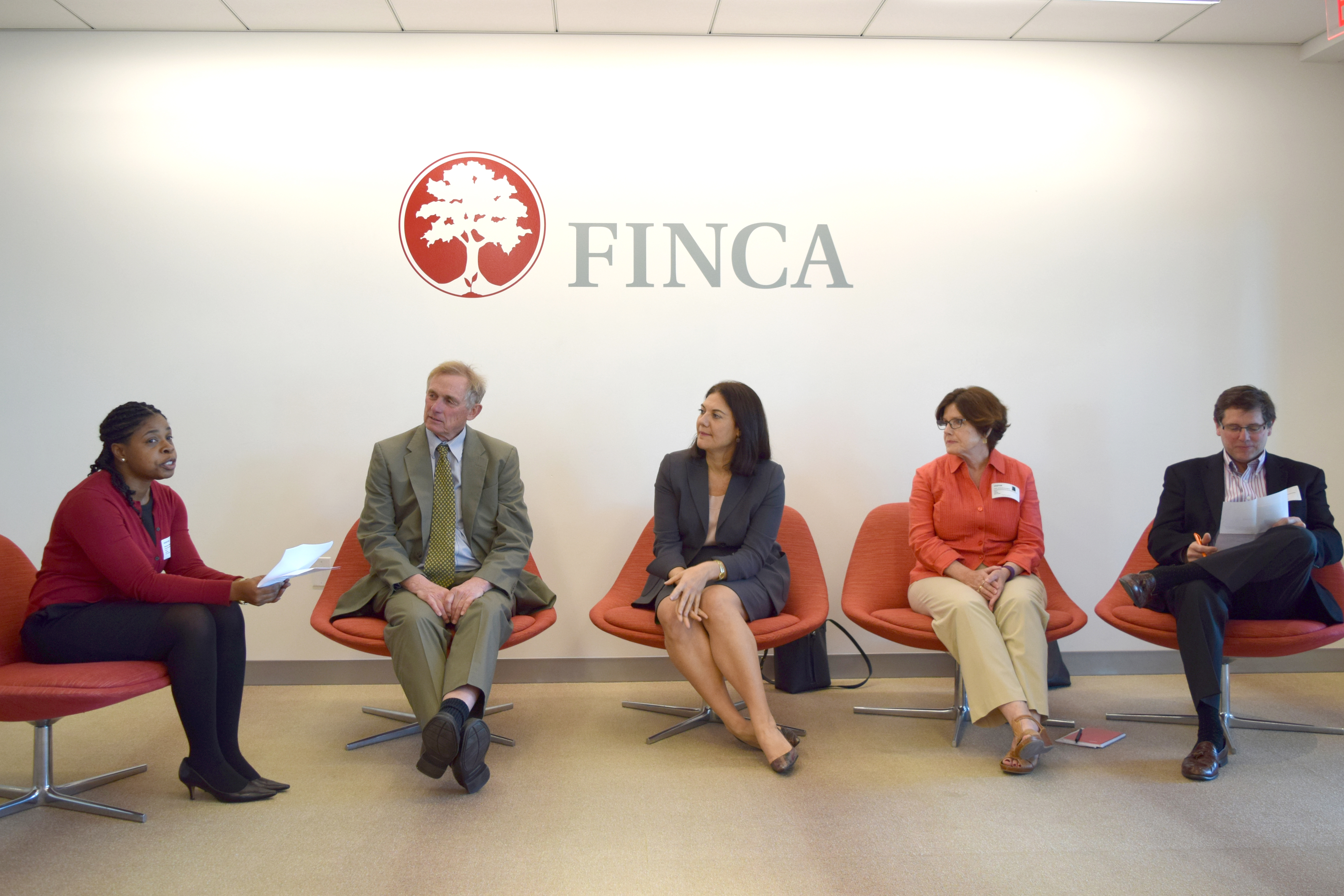 PRFI members gather for a Month of Microfinance event at FINCA International offices, 2016.